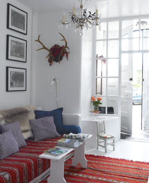 scandinavia meets africa. moroccan red rugs used as rugs and seating. I absolutely love this blending of cultures and continents. I would probably do Scandinavia meets Latin America but this is very inspiring.