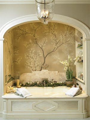 pretty back panel of marble on this tub, gorgeous wall paper. Makes for alovely bathing niche