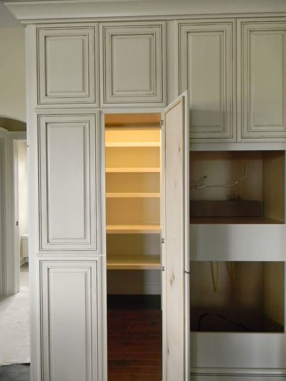 Pantry hidden pantry and walk in pantry on pinterest for Walk in pantry cabinets