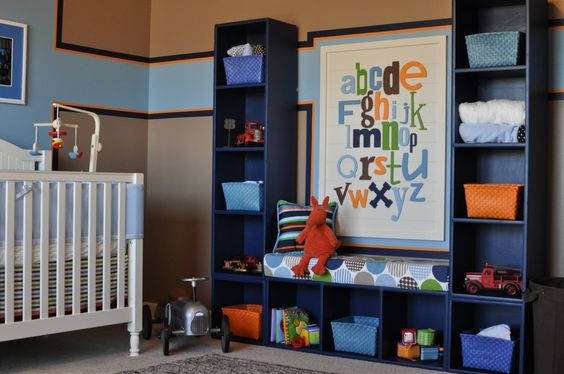 This storage solution was pieced together using bookcases and the bench cushioned sewed. #nursery