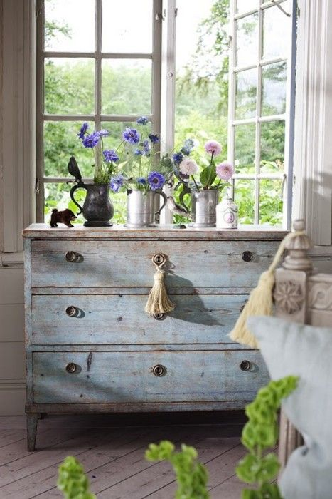 Beautiful . . . distressed chest, in pale.pale blue. Perfect in an all-white bedroom.