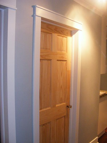 Door trim like this idea for the doors on main level for Wood trim around doors
