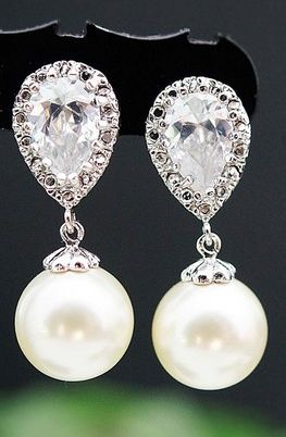 This were the earrings I wore on our wedding day 5/11/13 & Alex even loved them!! :) Swarovski pearl earrings