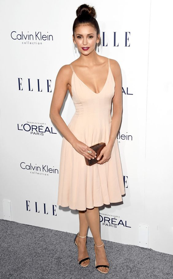 Nina Dobrev from 2015 Elle Women in Hollywood Awards  The Vampire Diaries star puts her hair up while working a cream colored dress.