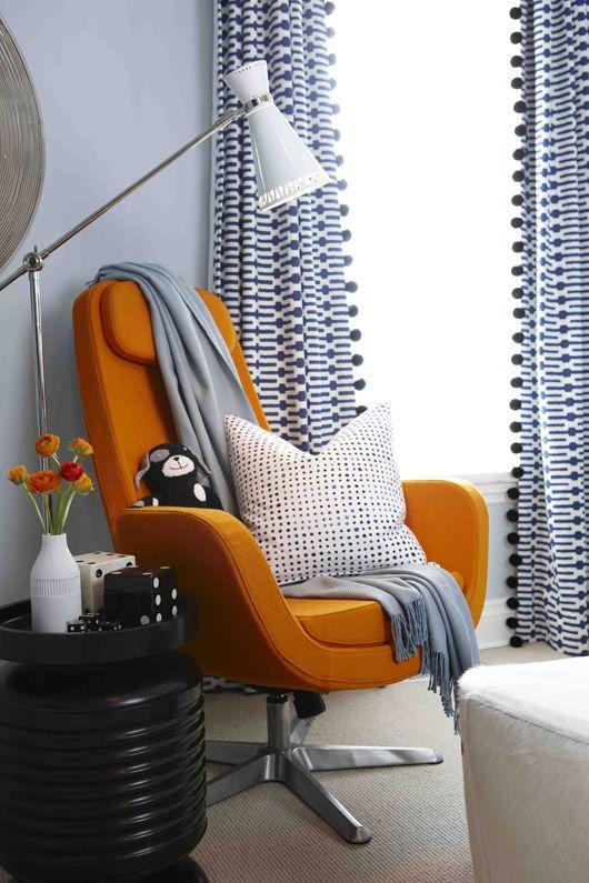 Sarah Richardson Design: Indigo blue geometric drapes with ball fringe. Fabric to use: Links in Indigo: