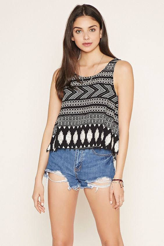 A sleeveless woven top with an allover tribal print, a V-cutout back, and beads along its hem.