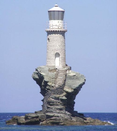 This lighthouse sits upon the craggy rock as though carved from it.