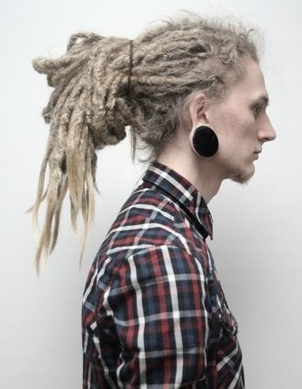 Dreadlocks and gauges...this guy is beautiful.