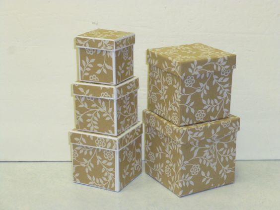 Re-covered Dollar Tree gift boxes;  tutorial -  http://thedollardiva.wordpress.com/2012/12/20/re-covered-dollar-tree-gift-boxes/