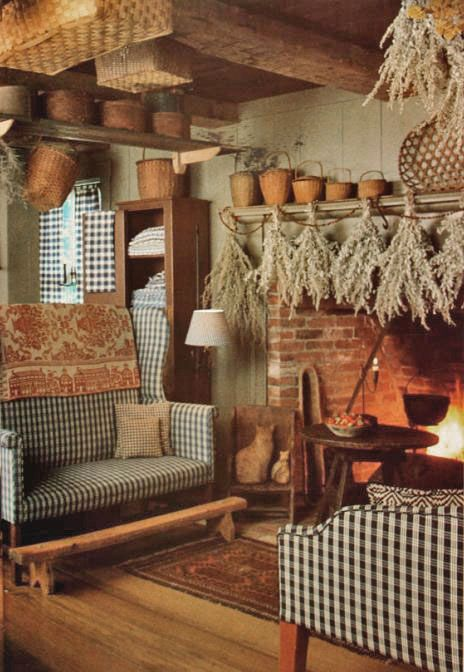 I like the two parson benches, the short foot stand and drying herbs over fireplace.