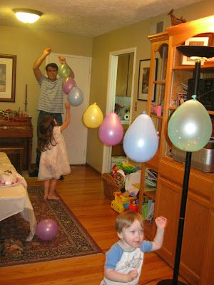 I have to say, a new spin on a pinata.  Single balloons filled with confetti and a few toys and candies.  Each child chose one to pop with a pin.  Each time was a surprise.