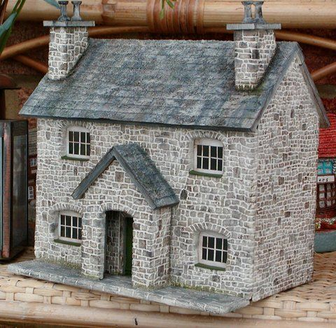 Stone style Dollhouse, the colorwork on these stones, the window setting, and the roof of this house are wonderful.: