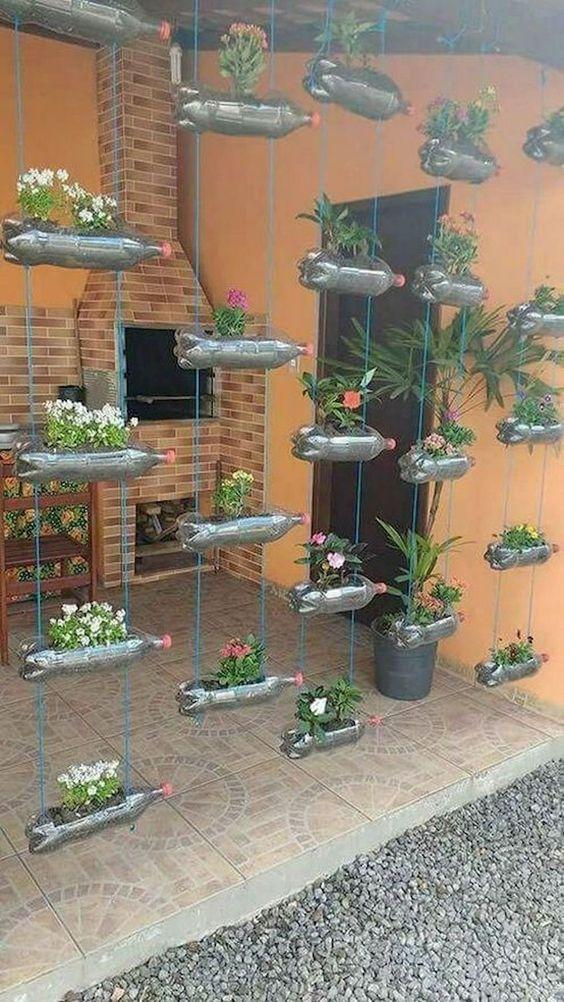 recycleld hanging planters made of softdrink bottles #gardenIdeas #garden #gardening #plants #homeDecor #indoor