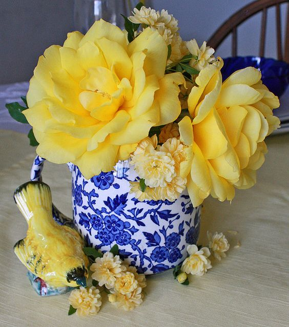 Blue Amp White Vase Filled With Yellow Flowers And A