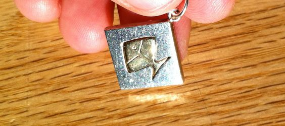 Kupittaan Kulta Finland 925s Sterling Silver and 10Kt Gold Fish Pendant (1960-70s). $95.00, via Etsy.