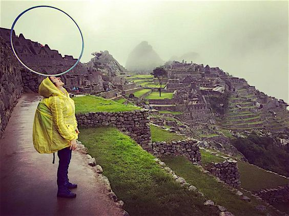 Machu Picchu Hula Hoop Balancing with Marianna De Sanctis. Marianna balances a hula hoop on her head at Machu Picchu in Peru. Photo by Florent Lestage.