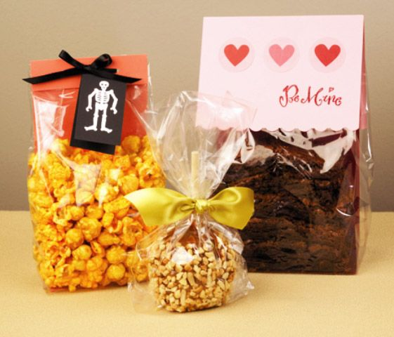 Fall Holiday Gift Bag Ideas - cellophane bags. Yes, yellow, orange and red, packed with home-made candy and closed with a pretty, autumn print...