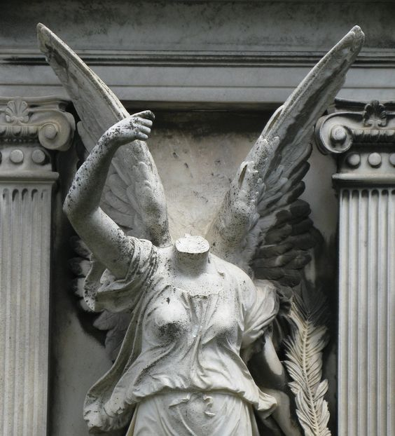 Headless, winged statue