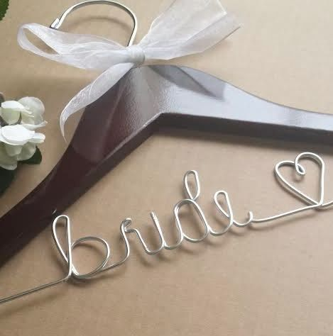 These wedding hangers are a unique prop for your wedding dress photos, and also make wonderful personalized keepsakes for the bride and