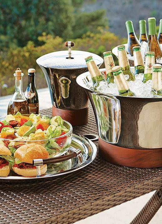 Entertain stylishly and easily with the Collins Serving Collection; with stainless steal finishes designed to chill beverages and finger foods without condensation.