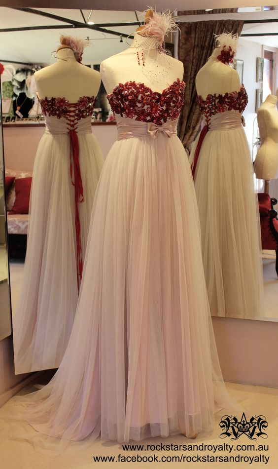 Corseted blush pink silk satin and tulle gown with red sequin flower appliques and Swarovski crystals on the bodice, by Rockstars and Royalty
