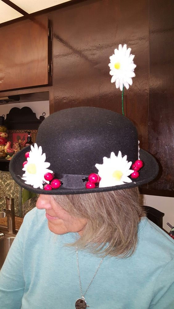 Mary Poppins hat, made felt daisies, used  cranberries. Super easy and way less expensive than buying it, it was less than $8.00.