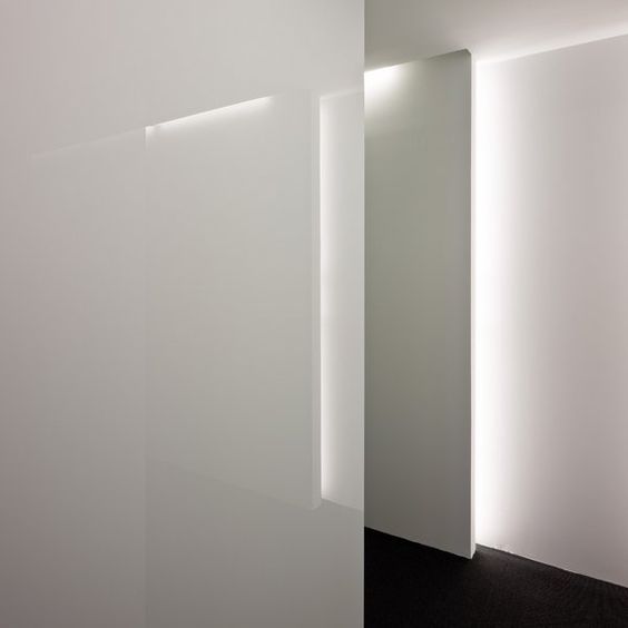 Beautiful combination of glossy white finish and indirect lighting, Acer office in Barcelona by Francesc Rife _