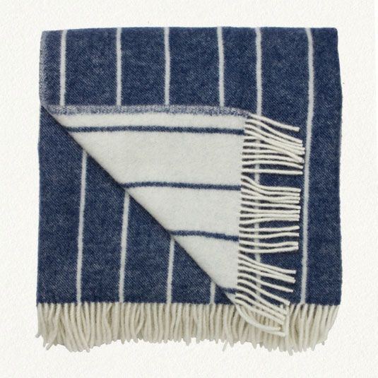 handmade Lithuanian merino throw blanket in white and deep indigo stripes