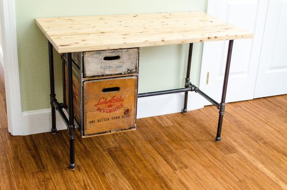 A Desk Made Out Of Reclaimed Lumber Used Black Pipes