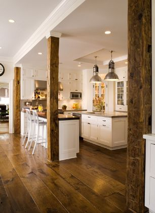 Love this white kitchen cabinets, wood floor same as the columns...tresses in family room to match beams