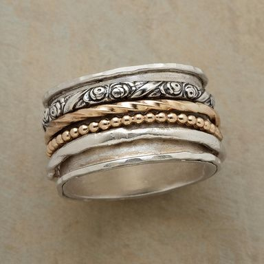 ANTHOLOGY RING--Four rings spinning in a single volume, each with a story to tell. Two of the revolving rings match the sterling silver base band