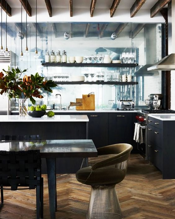 Chic New York Loft With a Hint of Edge || Herringbone Floors and a mirrored kitchen wall