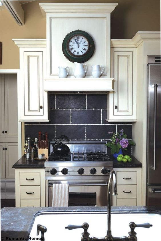 Love the cabinetry and back splash tile.