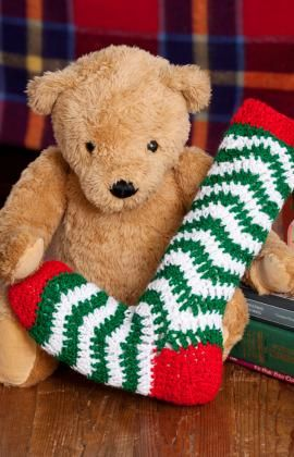 Holiday Ripple Stocking Crochet Pattern - Made from the toe up, this festive stocking in a classic ripple pattern is sure to be a holiday favorite. Make several stockings mixing and matching the colors so they are all different.