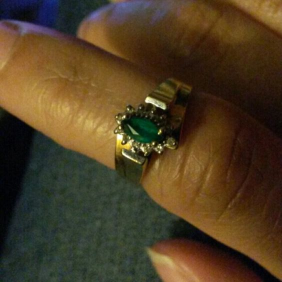 10kt Yellow Gold Emerald and Diamond Ring Sz 7 10kt Yellow Gold Bi-Level, Marquise Emerald accented with Diamonds.  This Ring is a Size 7 This is a Great Ring for those May Babies! Jewelry Rings