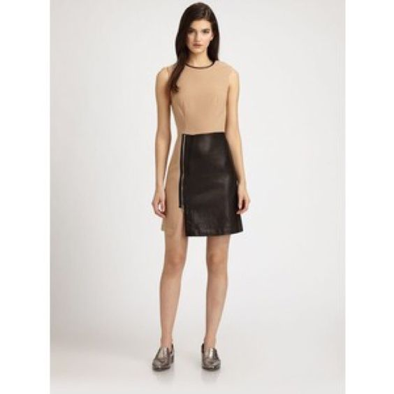 3.1 Phillip Lim Leather Panel Dress Wool-blend dress in tan and with black leather panel on skirt and detail on collar. Has silver zipper on skirt and a hidden zipper on one shoulder. Great dress! 3.1 Phillip Lim Dresses