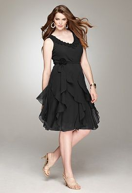 Another beautiful black dress. Very flattering for a curvy girl like me!