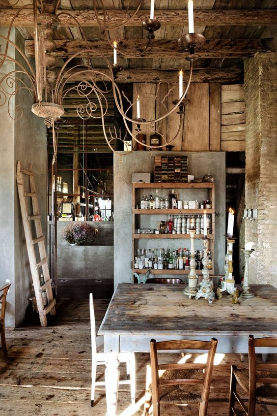 love the free-standing smooth concrete/stucco wall divider, and the rustic shelving in front of it!