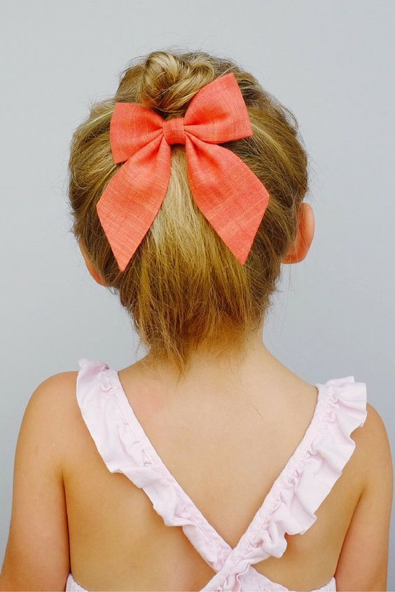 Classic chambray bow in vibrant coral attached to an alligator clip. Love this styled below a cute little top knot. // FreeBabesHandmade.com: