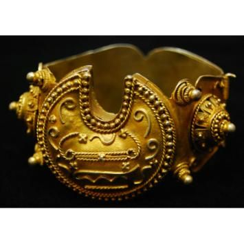 Maker: Tukulor peoples Bracelet (galbe, lam u teg) Date: Early to mid-20th century Medium: Gold alloy Dimensions: H x W x D: 6.6 x 7.7 x 1.4 cm (2 5/8 x 3 1/16 x 9/16 in.) Credit Line: Gift of Dr. Marian Ashby Johnson Geography: Senegal