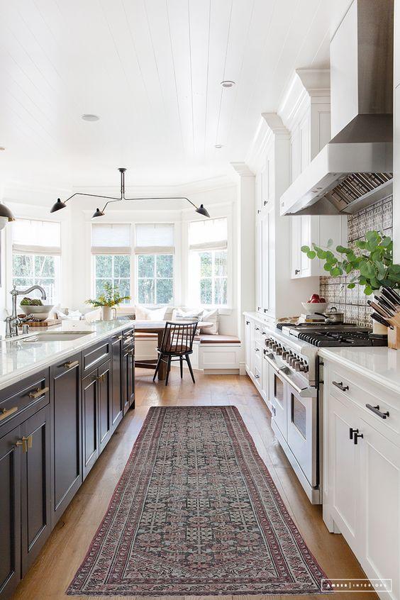 Gorgeous kitchen design with dark gray island and white cabinets - Amber Interiors - #kitchenremodel #kitchen #kitchendesign