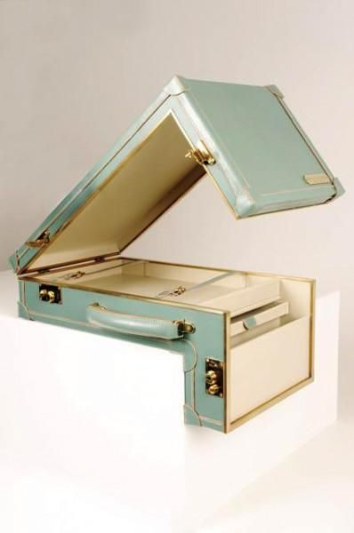 Sarah Williams suitcase - interesting but not vintage The suitcase. A metamorphosed version of a briefcase around the needs of a modern working person, designed to fit a Mac Book Laptop with straps to hold in position. There is a drawer ideal for paper documents.