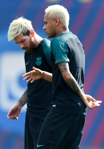 Neymar Jr. (L) and Lionel Messi of FC Barcelona look on during a training session ahead of their UEFA Champions League Group C match against Celtic FC at Ciutat Esportiva of Sant Joan Despi on September 12, 2016 in Barcelona, Catalonia.