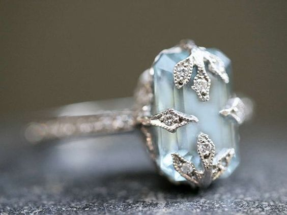 This classic and much-coveted Cathy Waterman ring features an emerald-cut aquamarine stone set in diamond-studded prongs whose sparkling vines calls to mind an enchanted forest.