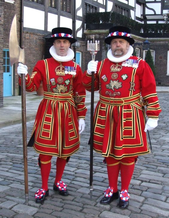 """Beefeaters"" - Tower Warders in ceremonial 'Tudor State' dress (their day uniform is 'undress blue'). The 'Ravenmaster' feeds raw meat to the resident ravens at The Tower daily, making them the 'real beefeaters'."
