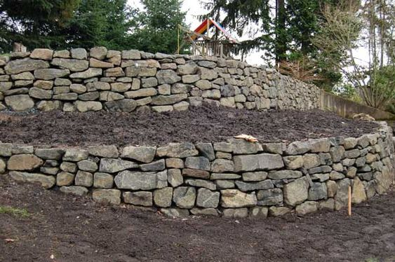Rock wall retaining walls and rock wall landscape on for Rock wall garden