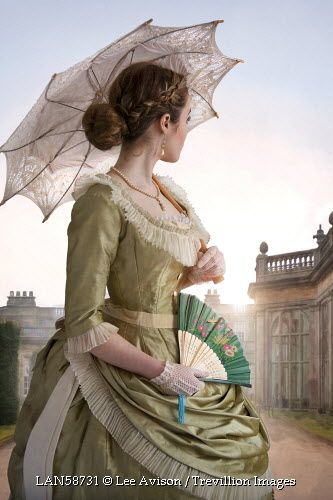Trevillion Images - victorian-woman-with-umbrella-by-country-house: