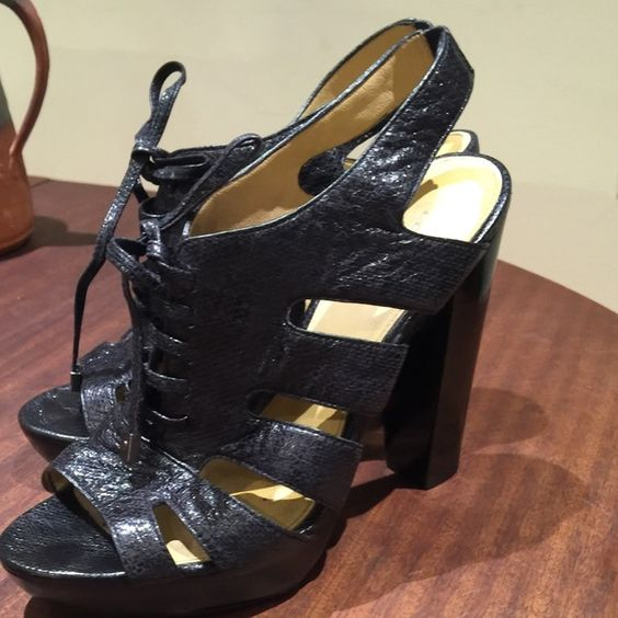 """Coach Moreen Sandals Lace-up sandal with textured embossing--dramatic laced design with bold cutouts on the sides. Leather lace has Coach-branded metal ends. 4-1/2"""""""" heel, 1"""" platform. Leather upper, lining and partial sole.  Re-soled, no scuff marks nor damage--like new condition. Coach Shoes"""