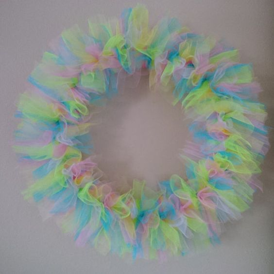 Spring Tulle Wreath. Ornaments can be added as decor. Colors can be customized. Shown: Taffy Pink, Turquoise, Yellow, Green, Lavender