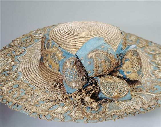 Gold straw picture hat with blue silk and gold lace trim, 1780.